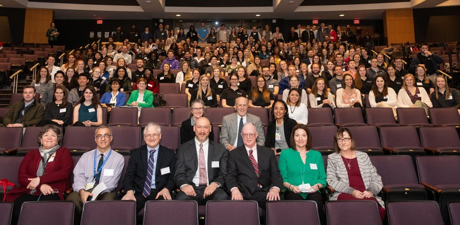 Students, faculty and staff participants at IPE Day pose in a group