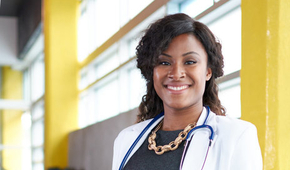 African American female doctor smiling in white coat